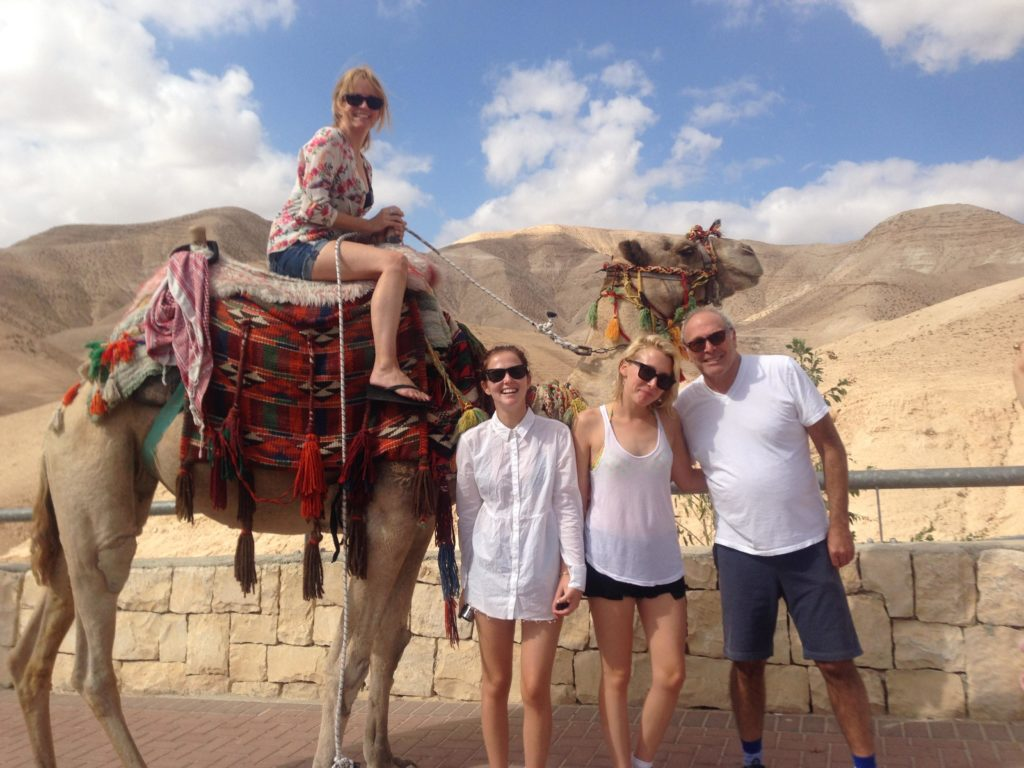 Lea Thompson sits on a camel, next to (left to right) her daughters Zoey and Madelyn Deutch and husband Howard Deutch.(America's Voices in Israel)