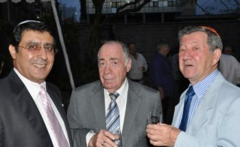 Albert Attias, left, and Charles Zslapak, right, and an unidentified man celebrate the centennial of Nairobi Hebrew Congregation, Sept. 9, 2012. (Nairobi Hebrew Congregation)