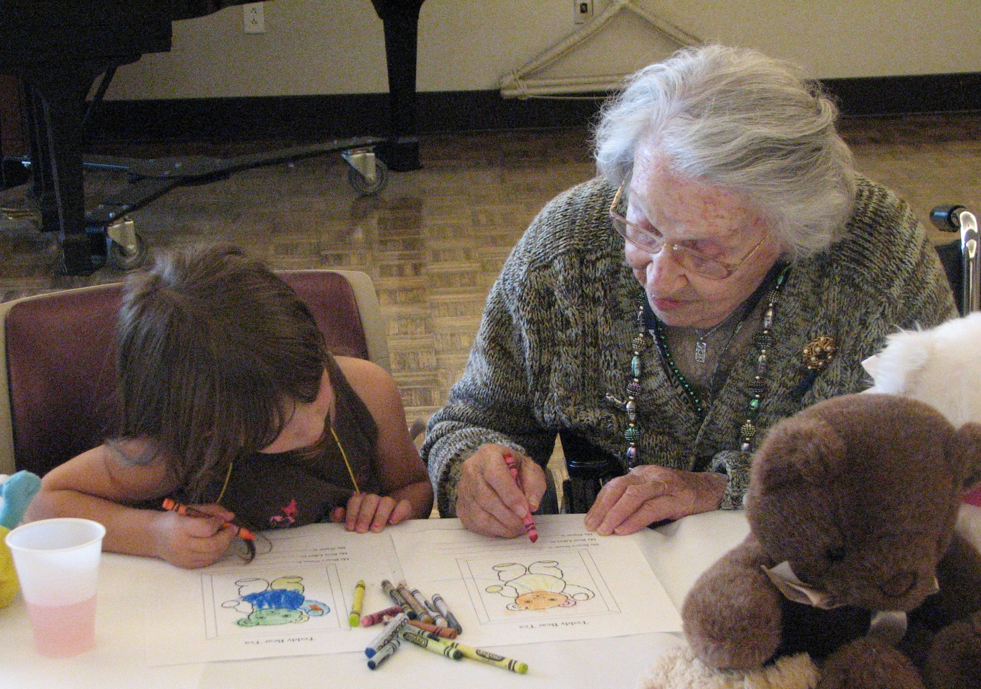 Theresa Hirschbein, 102, a resident of the Jewish Home and Care Center in Milwaukee, colors with a student from a Jewish day school.