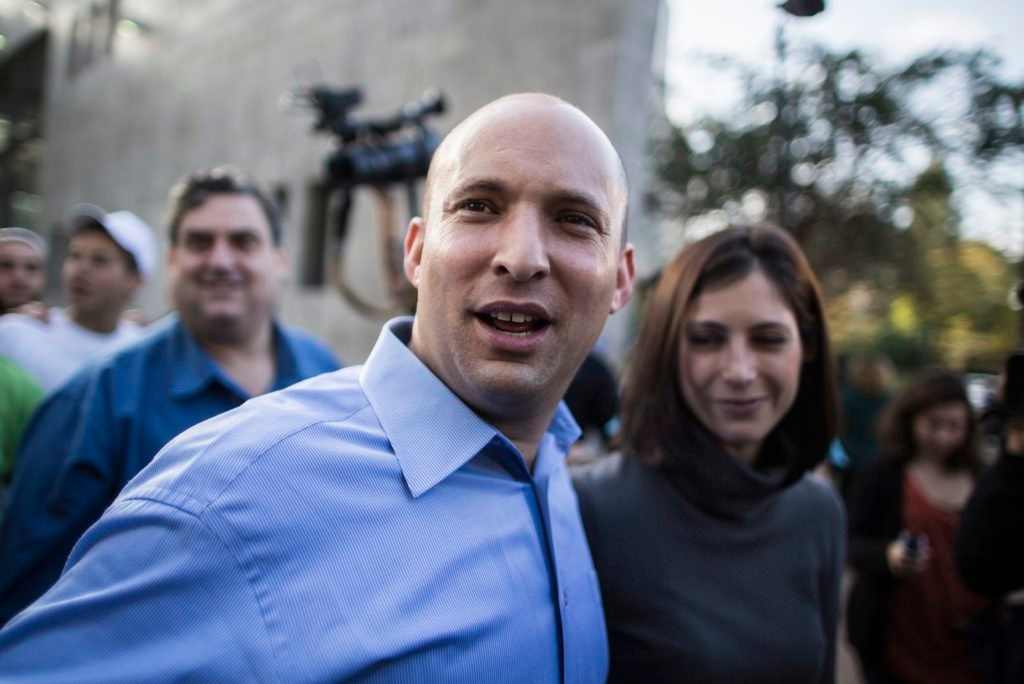 Naftali Bennett says his wife, Gilat, right, only drew closer to Judaism when the couple lived in New York. (Ilia Yefimovich/Getty Images)