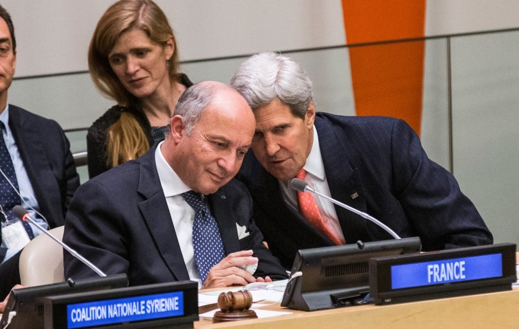 French Foreign Minister Laurent Fabius, left, conferring with U.S. Secretary of State John Kerry on the sidelines of the 68th United Nations General Assembly, Sept. 26, 2013. (Andrew Burton/Getty Images)