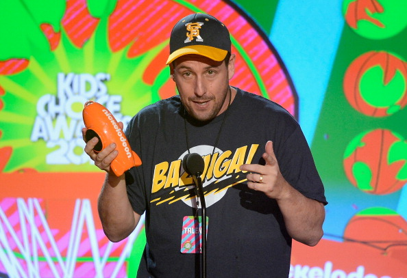 "Adam Sandler accepts the ""Favorite Voice from an Animated Movie"" award for ""Hotel Transylvania"" onstage during Nickelodeon's 26th Annual Kids' Choice Awards on Mar. 23, 2013 in Los Angeles. (Kevork Djansezian/Getty Images for KCA)"
