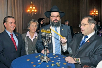 U.S. Rep. Jerrold Nadler (D-N.Y.), right, lights a Chanukah Menorah in the Mansfield Room of the Capitol on the seventh night of Chanukah 2013 in Washington, D.C. on Dec. 3, 2013. Looking on, from left to right: Rep. Ed Royce (R-Calif.); Rep. Jan Schakowsky (D-Ill.); and Rabbi Levi Shemtov, director,  American Friends of Lubavitch (Ron Sachs)