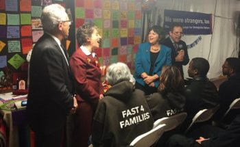 Rep. Alan Lowenthal (D-Calif.), Rep. Jan Schakowsky (D-Ill.), NCJW President Nancy Kaufman, and JCPA director Rabbi Steve Gutow say the blessings over the Hanukkah candles on Dec. 4 in a pro-immigration protest tent on the National Mall (JCPA)