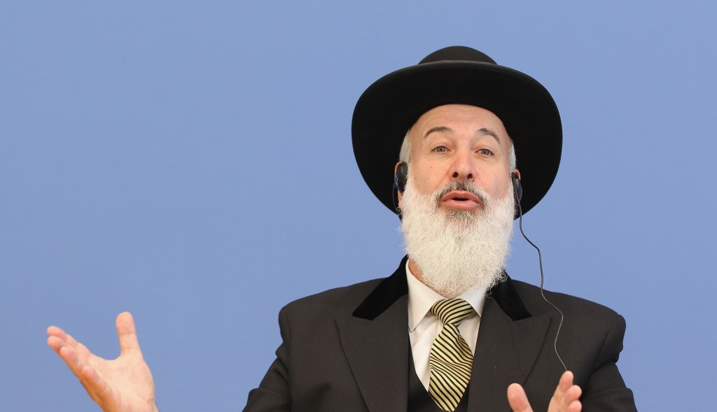 Former Israeli Chief Rabbi Yona Metzger addressing journalists following a 2012 court decision in Cologne, Germany, that the practice violates the bodily integrity of a child. (Sean Gallup/Getty Images)
