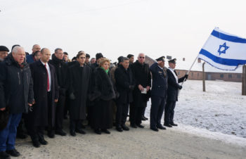 Israeli Knesset members singing the Israeli national anthem at the former Nazi death camp Birkenau on Jan. 27. Photo by Cnaan Liphshiz JTA