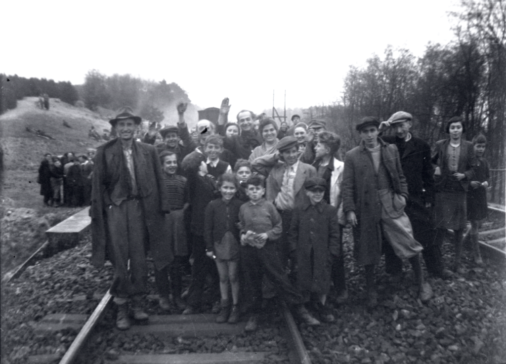 Former inmates who were transported by train from Bergen-Belsen were photographed in Farsleben, Germany, shortly after their liberation by U.S. troops on Apr. 13, 1945. (United States Holocaust Memorial Museum, courtesy of George Gross)