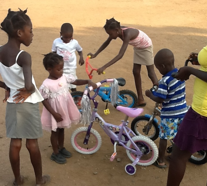Children from a Haitian orphanage playing with bicycles that they received from Sarah Fiske. (Rilden Desamoures)