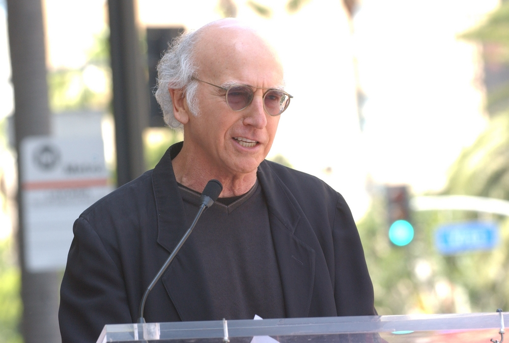 Larry David speaks as Julia Louis-Dreyfus is honored with a Star on the Hollywood Walk Of Fame in 2010 (Albert L. Ortega/PR Photos)