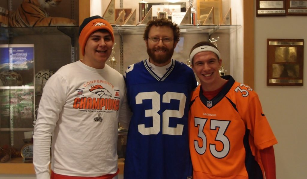 Denver Academy of Torah teacher Benjamin Levy, center, is rooting hard for his hometown Seattle Seahawks, but is mindful of his students' passion for their native Denver Broncos. (Courtesy Benjamin Levy)