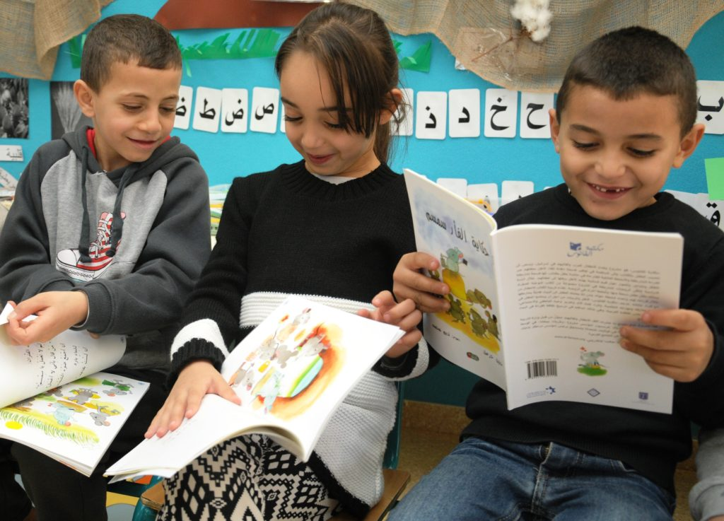 Israeli Arab children at a school in Baqa al-Gharbiyye reading books from the Lantern Library, a spinoff of the Harold Grinspoon Foundation's PJ Library. (Harold Grinspoon Foundation)