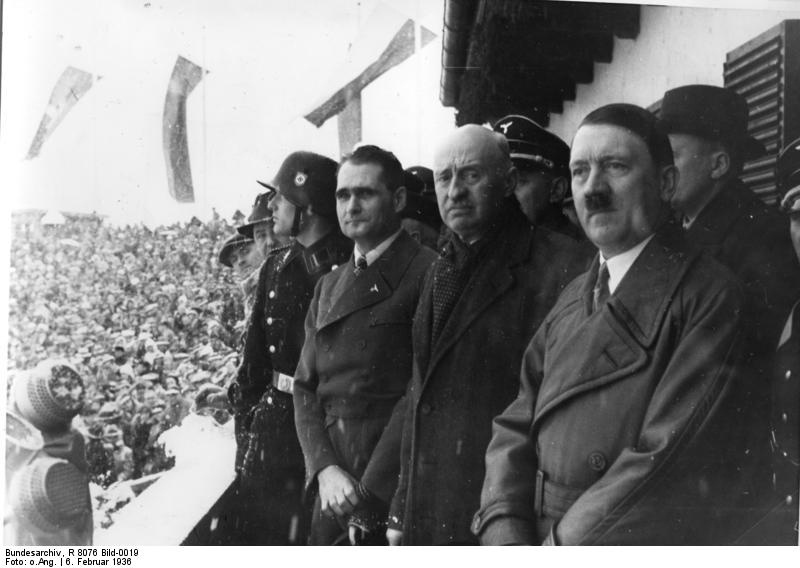 Rudolf Hess, International Olympics Committee President Henri de Baillet-Latour and Adolf Hitler at the opening ceremony of the 1936 Winter Olympics (Wikimedia Commons)