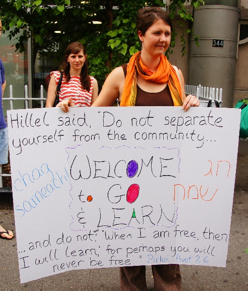 "A Jewish Voice for Peace activist protests outside New York City's 14th Street Y in May 2012 after the Jewish institution canceled a ""Go and Learn"" event organized by the group's youth arm that was scheduled for a rented room in the Y's building. (Courtesy of Jewish Voice for Peace)"