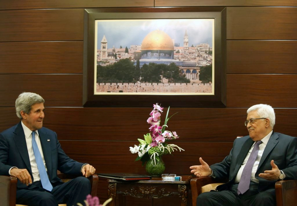 U.S. Secretary of State John Kerry meets with Palestinian Authority President Mahmoud Abbas on July 19, 2013 in Ramallah. (Fadi Arouri, Pool/Getty Images)