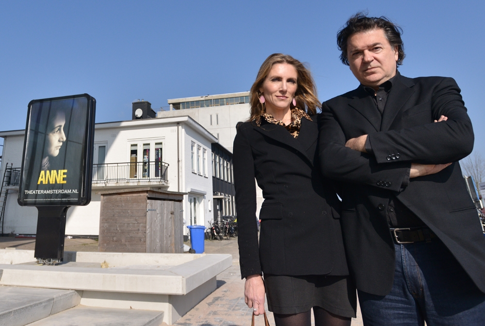 """ANNE"" co-writers Leon de Winter and Jessica Durlacher stand outside the Amsterdam theater that is being built as a venue for their play on March12, 2014. (Cnaan Liphshiz/JTA)"