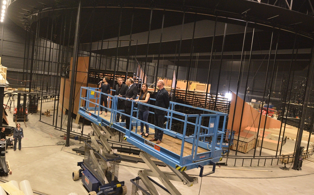 "Cast and production crew examine the still unfinished Amsterdam theater that is being built as a venue for the play ""ANNE"" on March 12, 2014. (Cnaan Liphshiz/JTA)"