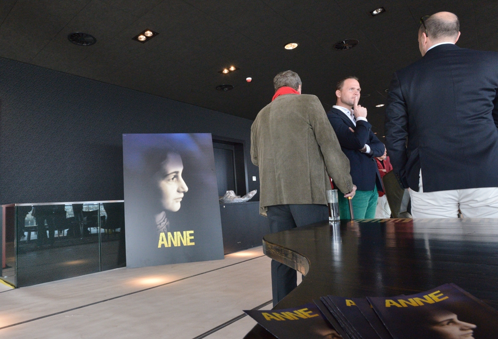 "Dutch journalists attend the sneak preview of the new Amsterdam theater that is being built as a venue for the play ""ANNE"" on March 12, 2014. (Cnaan Liphshiz/JTA)"