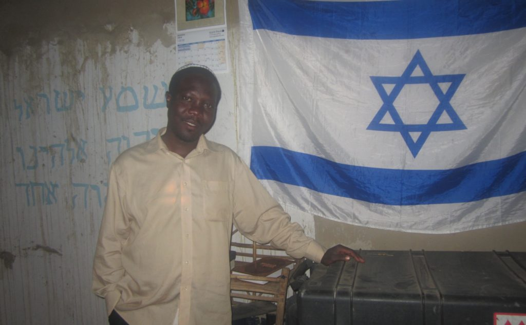 Enosh Keki Maniah, the head of the breakaway Orthodox faction of Uganda's Abayudaya Jewish community, hopes to move to Israel.  (Ben Sales)