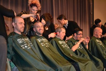 An assembly line of rabbis get their heads shaved at the CCAR convention in Chicago. (Julie Pelc Adler)