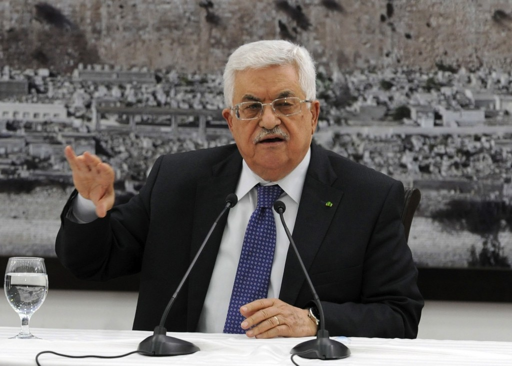 Palestinian Authority President Mahmoud Abbas meets with journalists in Ramallah on April 22, 2014, a day before his Fatah faction signed a reconciliation agreement with the militant group Hamas.  (Palestinian Press Office via Getty Images)