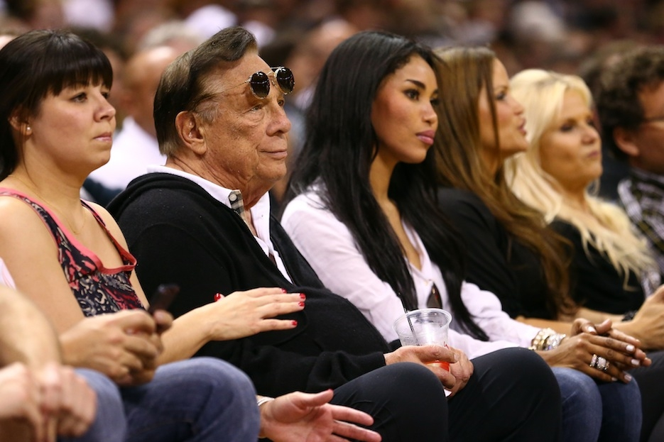 Los Angeles Clippers owner Donald Sterling is pictured here at a 2013 basketball game with V. Stiviano. (Ronald Martinez/Getty Images)
