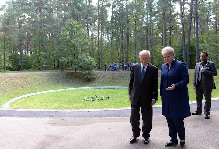 Israeli President Shimon Peres and Lithuania's President Dalia Grybauskaite attend a remembrance ceremony at Paneriai Memorial on August 01, 2013 near Vilnius, Lithuania. Around 100,000 victims, more than half of them Jewish, were murdered at the site by the Germans and Lithuanian groups during World War II. (Moshe Milner/Israeli Government Press Office via Getty Images)