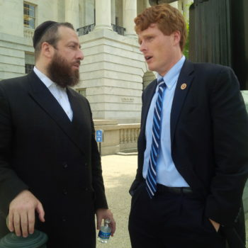 Ezra Friedlander, left, chats outside the U.S. Capitol with Rep. Joe Kennedy (Mass.) on May 19 after Congress passed a bill awarding Israeli President Shimon Peres its Gold Medal. Kennedy cosponsored the bill with Rep. Trent Franks (R-Ariz.) and Friedlander led lobbying for it. (Ezra Friedlander)