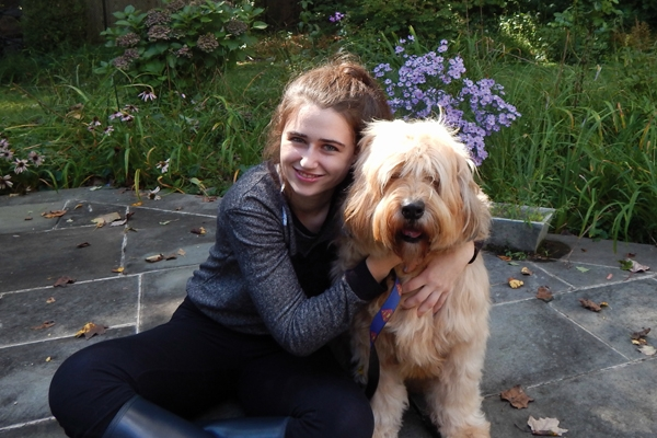 Annie Blumenfeld poses with Teddy, her furry inspiration. (Courtesy Annie Blumenfeld)