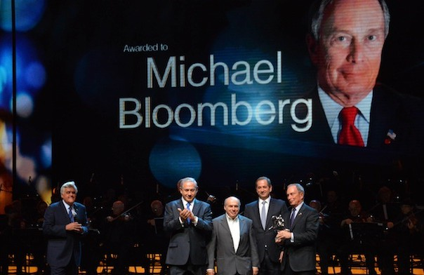 "New York City Mayor Michael Bloomberg, at far right, receives the Genesis Prize on May 22, 2014 at the Jerusalem Theater, where he is joined onstage by, from left, ceremony emcee and former ""Tonight Show"" host and emcee Jay Leno; Israeli Prime Minister Benjamin Netanyahu; the chairman of the Jewish Agency, Natan Sharansky; and the chairman of the Genesis Prize, Stan Polovets. (Ohad Zwigenberg/POOL/Flash 90)"
