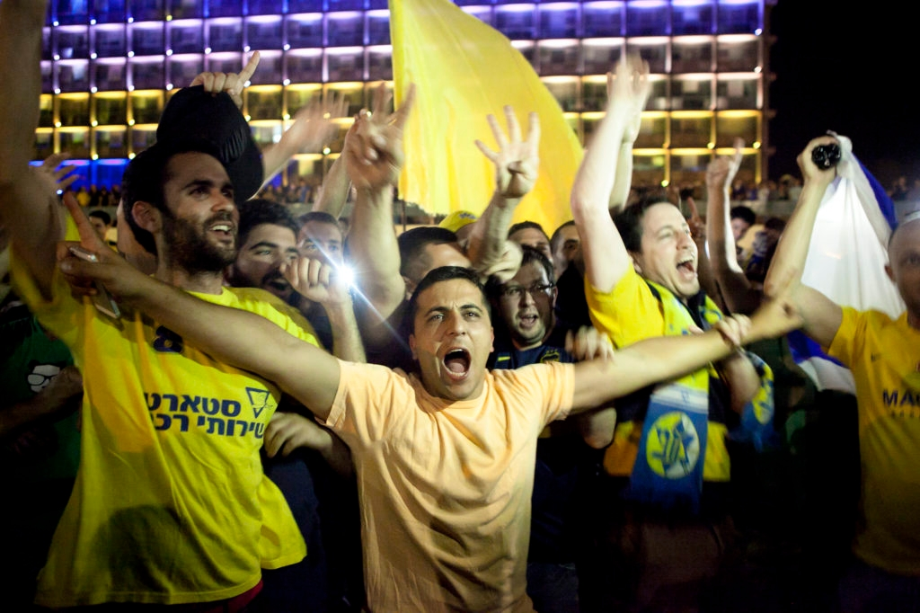 Thousands of Maccabi Tel Aviv fans celebrated at Rabin Square in Tel Aviv Sunday night as the Israeli team won in the Euroleague Finals, on May 18. (Amir Levy/Flash90