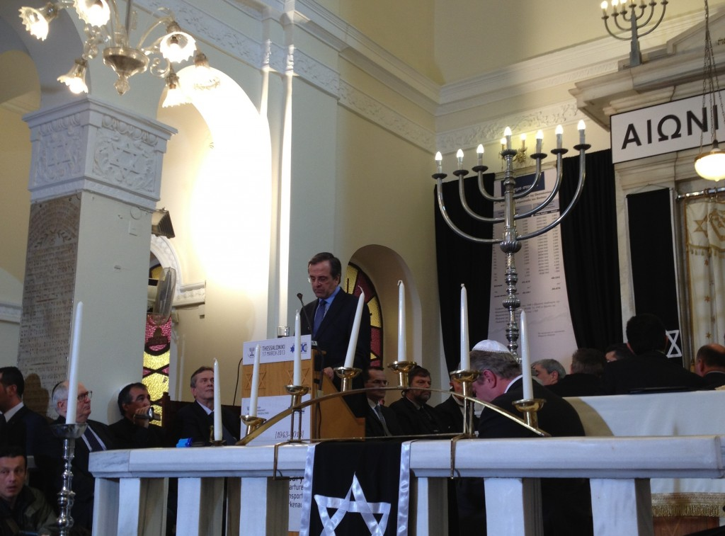 Greek Prime Minister Antonis Samaras speaks in a synagogue in Thessaloniki in March 2013, the first visit by a sitting prime minister to a Greek shul in more than a century. (Gavin Rabinowitz)