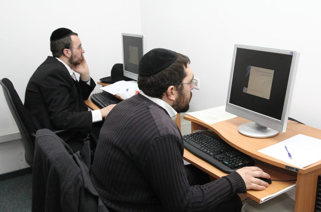 Haredi men studying toward professional degrees at Kemach, a Jerusalem-based organization that guides haredim through study programs and job placement. (Kemach)