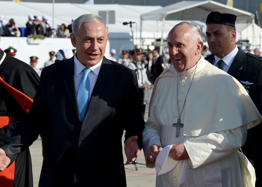 Pope Francis walks with Israeli Prime Minister Benjamin Netanyahu during a welcoming ceremony at Israel's Ben Gurion Airport on May 25, 2014. (Avi Ohayon/Israel Government Press Office via Getty Images)