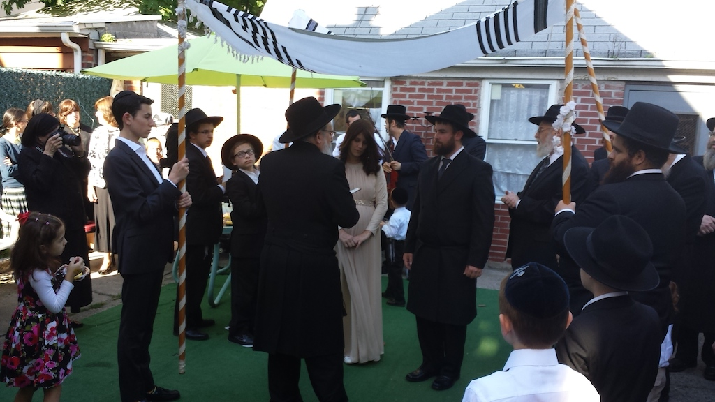 The newly Jewish Sholom and Nechama Mc Junkin's wedding ceremony Sunday night in Brooklyn attracted 100 people, many of them strangers. (Alexander Rapaport)