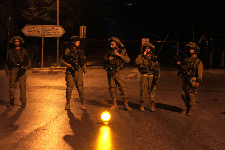 Israeli soldiers patrol at Birzeit University, on the outskirts of Ramallah in the West Bank during an operation on June 19, 2014. Israeli forces broadened the search for three teenagers believed kidnapped by Palestinian militants and imposed a tight closure on the town.  (Issam Rimawi/Flash 90)
