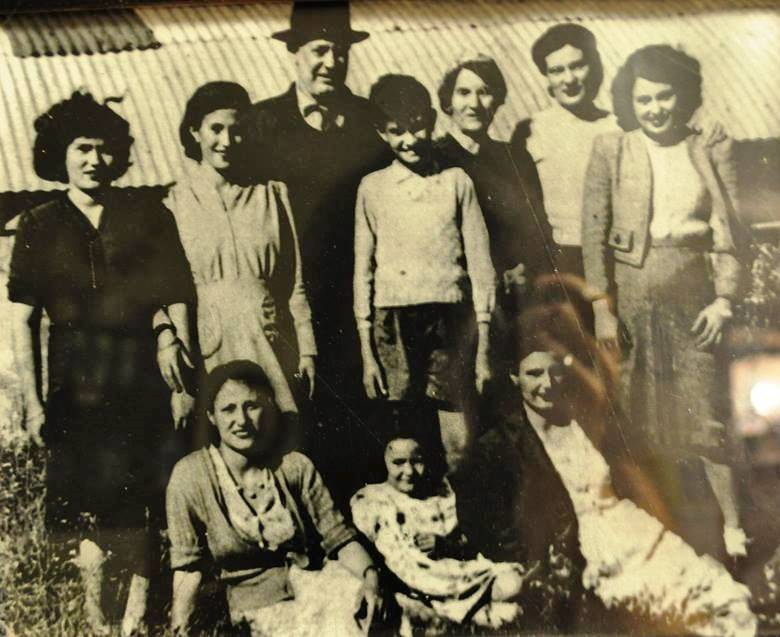 "Judith Mertz, shown as a little girl sitting with her family in early 1950s Israel, lives in Pennsylvania now but says she has family in her native land ""from Metulla to Eilat."" (Courtesy Judith Mertz)"