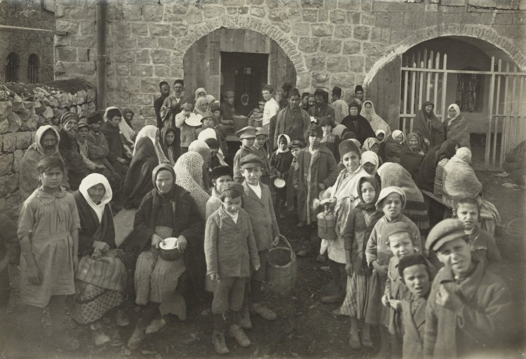 Jews wait for food outside the JDC-supported Dreyfus soup kitchen in Jerusalem in 1921. (Courtesy JDC)