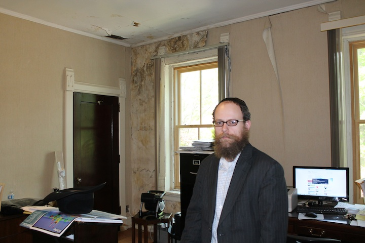 Rabbi Uri Perlman, founder of the Bais Menachem Youth Development program, runs the yeshiva out of a rundown building that used to be a real estate office. (Uriel Heilman/JTA)