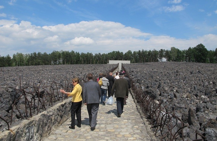 Participants in the ceremony marking the 10th anniversary of the memorial at the Belzec death camp walk through the field of slag toward the memorial wall. (Ruth Ellen Gruber)