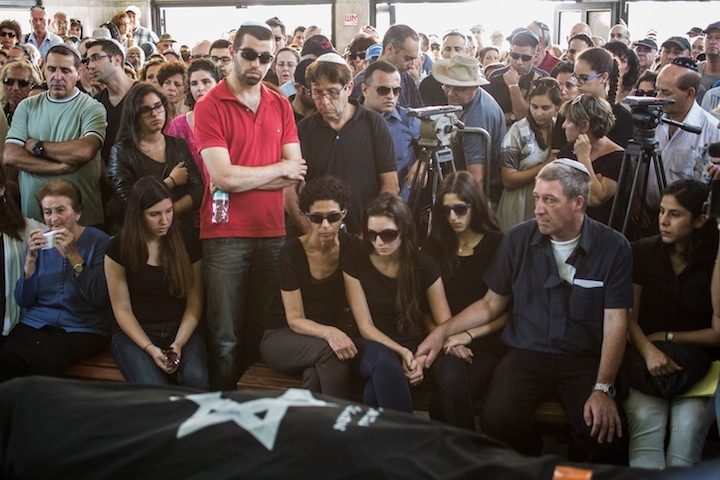 Relatives and family members mourn l in Tel Aviv during the May 27 funeral for Emanuel and Miriam Riva, the Israeli couple killed in the May 24 shooting attack at the Jewish Museum of Belgium in Brussels. (Ilia Yefimovich/Getty Images)