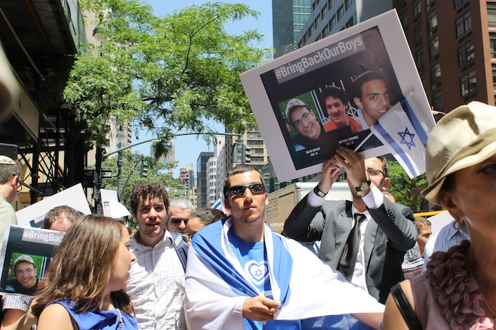 Demonstrators rally outside the Israeli consulate in Manhattan to express solidarity with three Israeli teens who were abducted in the West Bank, June 16, 2014. (Miriam Moster/JTA)