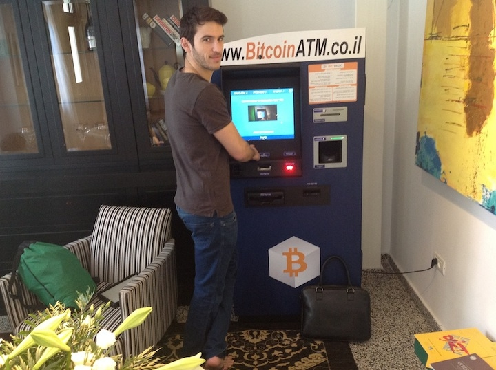 Nimrod Gruber uses Israel's first Bitcoin ATM in Tel Aviv, June 12, 2014. (Ben Sales/JTA)