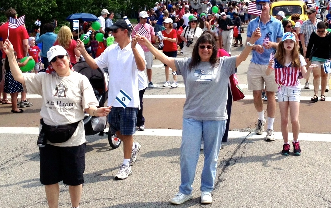 Members of the Aitz Hayim Center for Jewish Living in Glencoe, Ill., show U.S. and Israeli colors at the 2012 Fourth of July parade in nearby Highland Park. (Courtesy Aitz Hayim Center for Jewish Living)