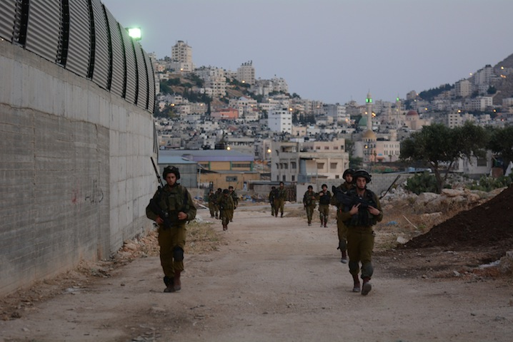 Israeli soldiers conduct a search patrol in the Balata refugee camp near Nablus in the West Bank, June 16, 2014. (IDF Spokesperson/Flash 90)