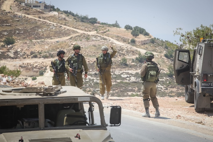 Israeli soldiers search around the Israeli settlement bloc of Gush Etzion in the West Bank, where three Jewish teenagers have gone missing and are feared to have been kidnapped. (Flash 90)