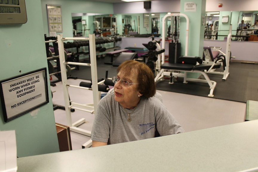 "Shirley Schoenholtz, who works in the JCC's fitness center, is skeptical of the plan to build a new $11 million Center for Jewish Life. ""What do we need a new one for?"" she asks. (Uriel Heilman/JTA)"