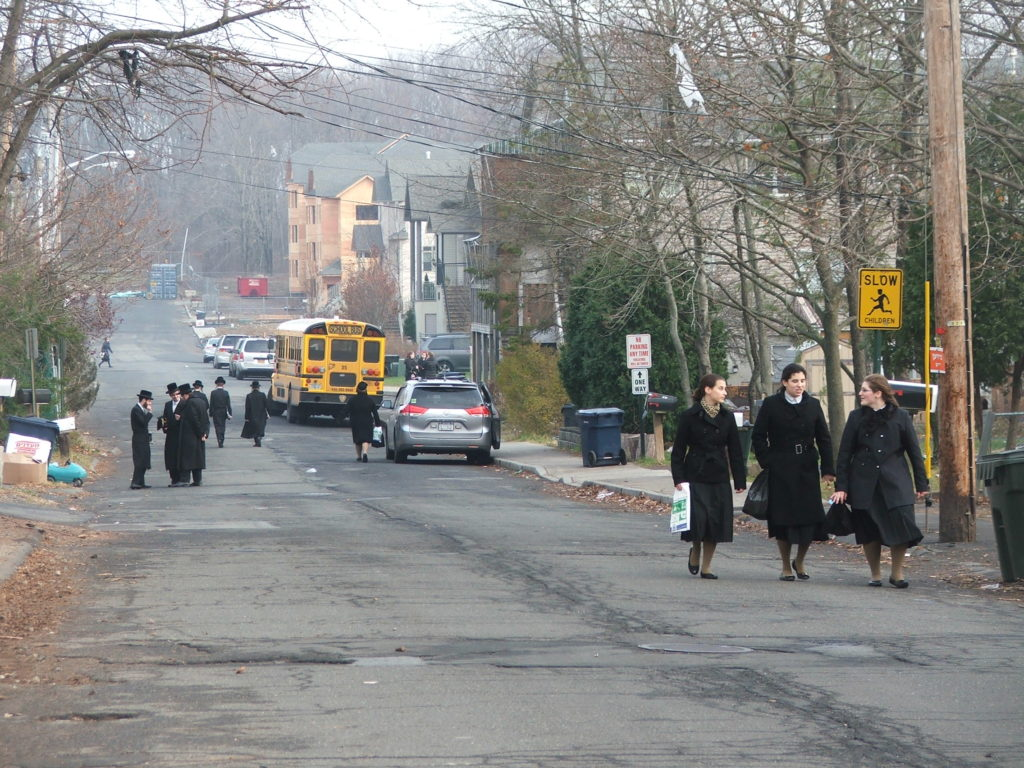 Young women walk on the designated women's side of the street in New Square, a Hasidic village in suburban New York. (Uriel Heilman)