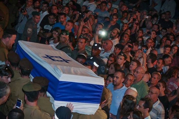 Tens of thousands of Israelis attending the funeral of Israeli soldier and Texas native Sean Carmeli, who was killed in Gaza, at the military cemetery in Haifa, July 21, 2014.