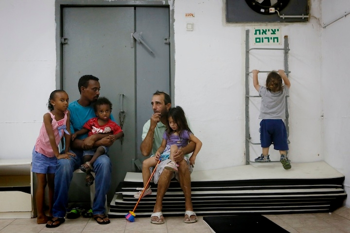 Israelis gathering in a public bomb shelter in the southern Israeli city of Ashkelon, July 18, 2014. (Miriam Alster/Flash 90)