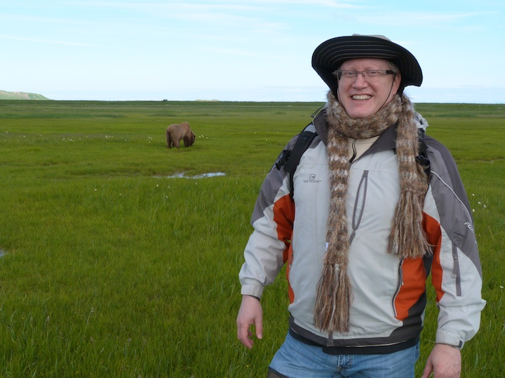 Donn Ungar, who is making aliyah, posing in in Alaska with a grizzly bear in the background. (Courtesy of Donn Ungar)